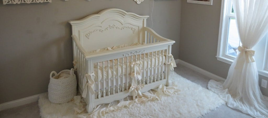 Whimsical flora & ethereal white bring this dream girl nursery to life!